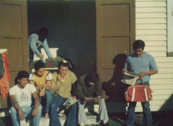 Dad (kutu comb on his head) hanging out in the 1970s with his Army mates. The social history context is gleaned through the objects present in this candid photo of a group of Māori men hanging out.