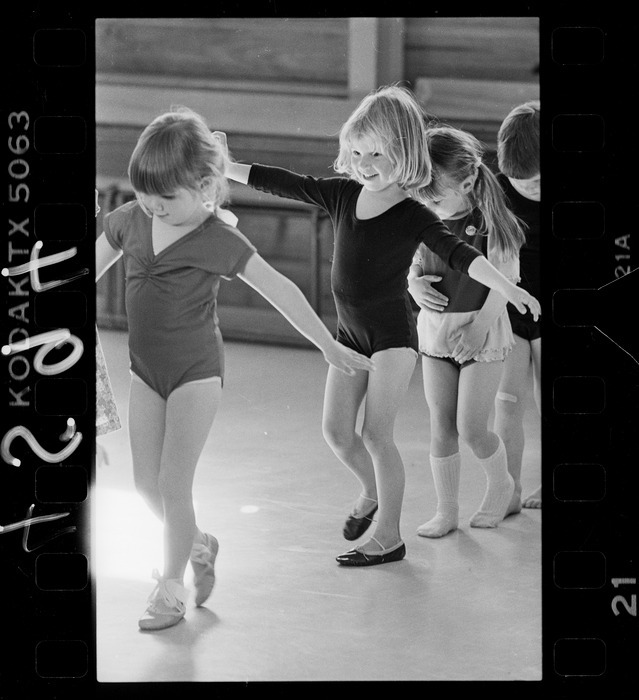 Young girls lined up for tightrope walking in class of Silverstream ballet teacher Joanne Jones - Photograph taken by Ian Mackley. Further negatives of the Evening Post newspaper. Ref: EP/1985/4594/21-F. Alexander Turnbull Library, Wellington, New Zealand.  http://natlib.govt.nz/records/23201184