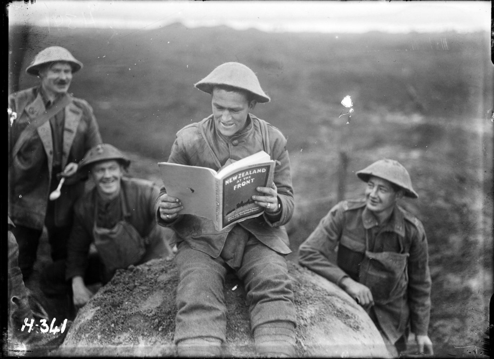 World War I New Zealander at the front reading a copy of 'New Zealand at the Front'. Royal New Zealand Returned and Services' Association :New Zealand official negatives, World War 1914-1918. Ref: 1/2-012978-G. Alexander Turnbull Library, Wellington, New Zealand. http://natlib.govt.nz/records/23023819