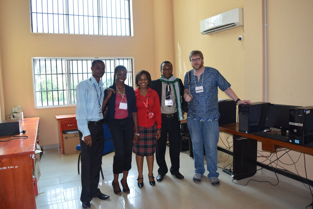 "From Chris: ""I have attached a photo of me next to the Koha server for Bowen University in Iwo, Nigeria. I like this photo because I never would have thought that I would end up working on an open source project that would take me to Nigeria"""