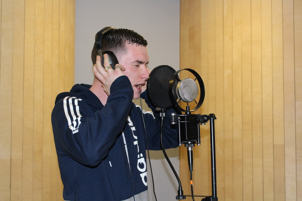 T.S.M.'s Will Casey recording rap vocals