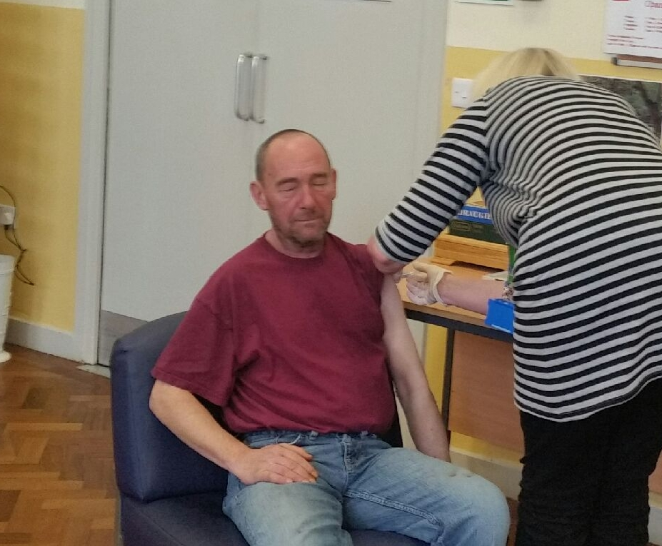 A guest recieving his flu jab - this ran within the centre and was so popular the NHS support ran out of flu vaccinations and another clinic was needed.