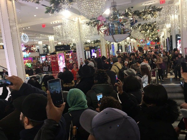 Demonstrators flood the entryway of Macy's on Friday morning, November 25, 2016.