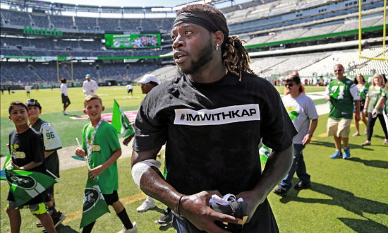 (right): Jay Ajayi, Miami Dolphins running back, warming up for today's big game against the NY Jets at MetLife Stadium.  Read more about the Dolphins protest  here .