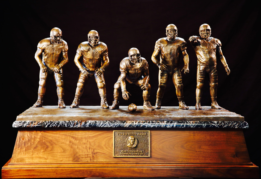 The bronze trophy for the Joe Moore Award will go to the Most Outstanding Offensive Line Unit in college football and, at more than 350 pounds, is the largest trophy in college football.