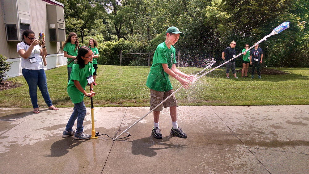 "4-H members participate in the ""Have a Blast with Rocketry"" program."