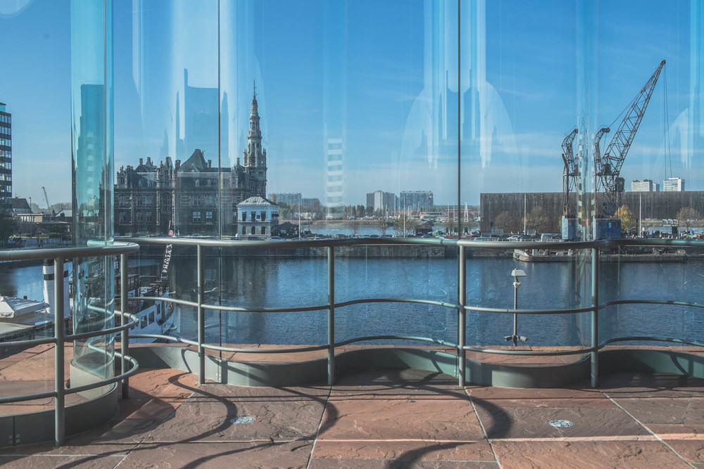 Curved transparent surface slightly distort the panoramic view of the city.