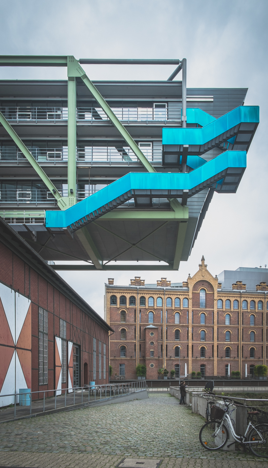 Inspiration of Zaha's Port House? Or inspired by?