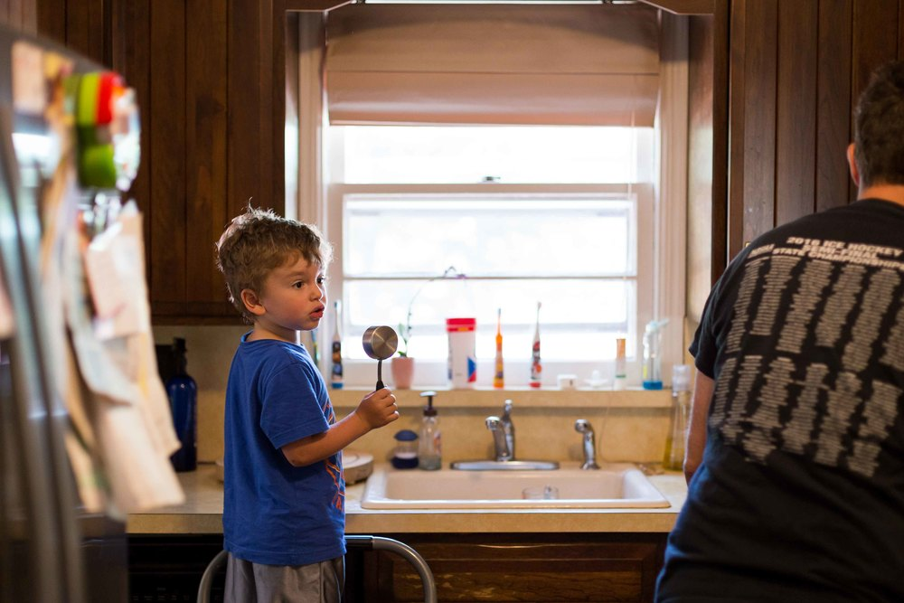 photo of a young boy making pancakes with dad, documentary session, oakland, nj