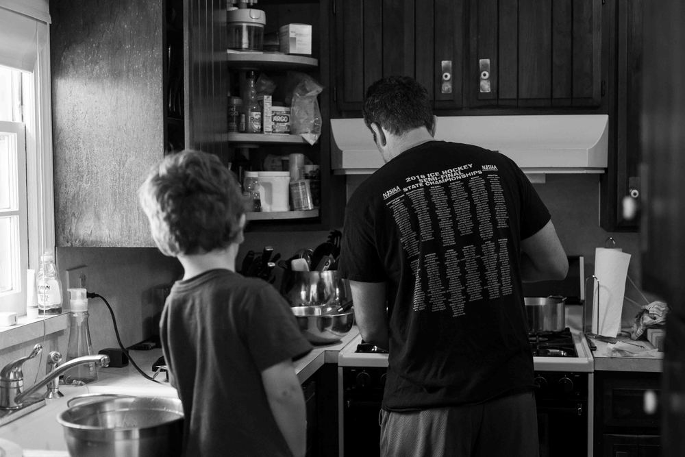 boy watching dad cook, oakland, nj, documentary family photography, erika kao