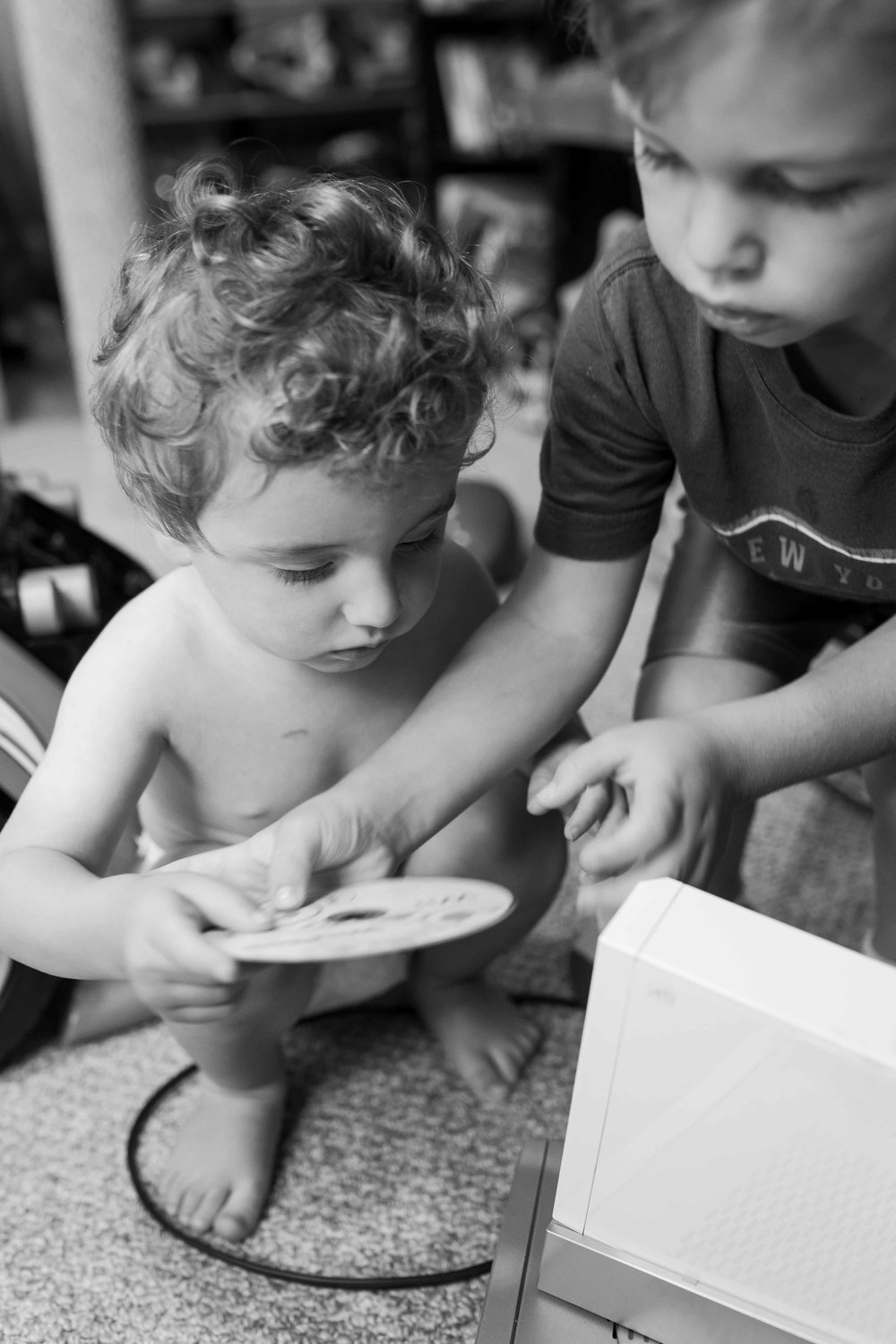 brothers playing with wii, black and white photos, documentary, oakland, erika kao
