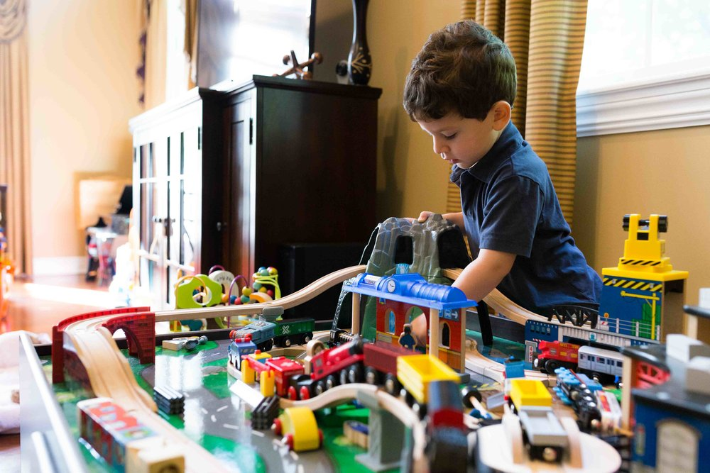 boy playing with his train table