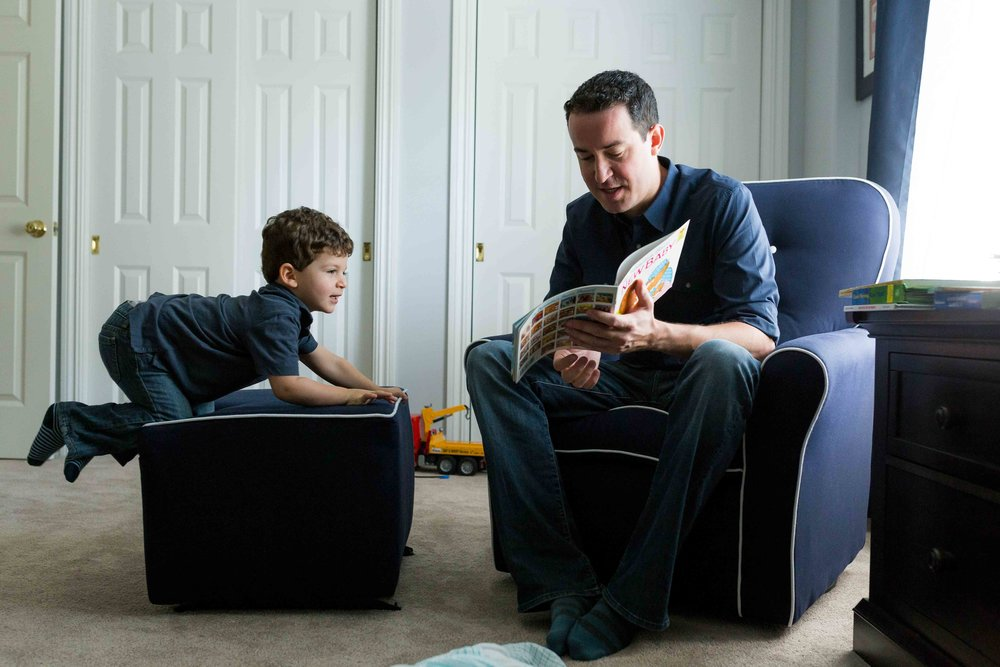 daddy reading to his son