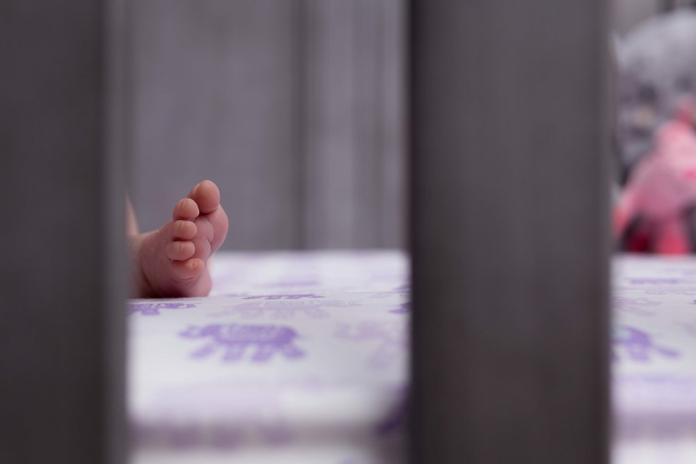 baby foot in a crib