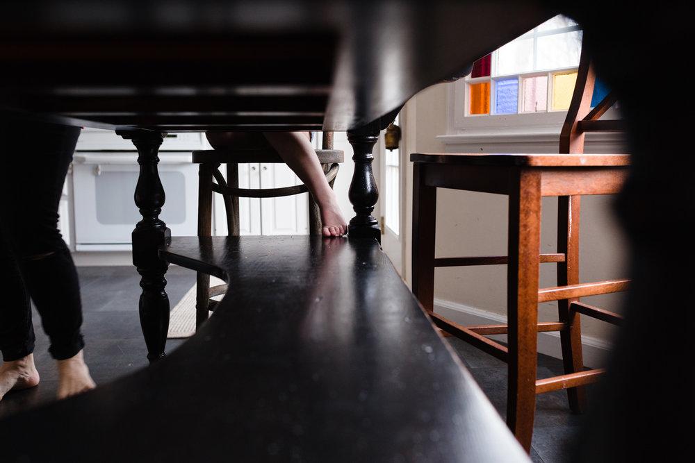 girl's feet under table