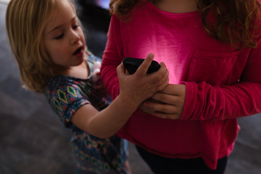 sisters fighting over a phone