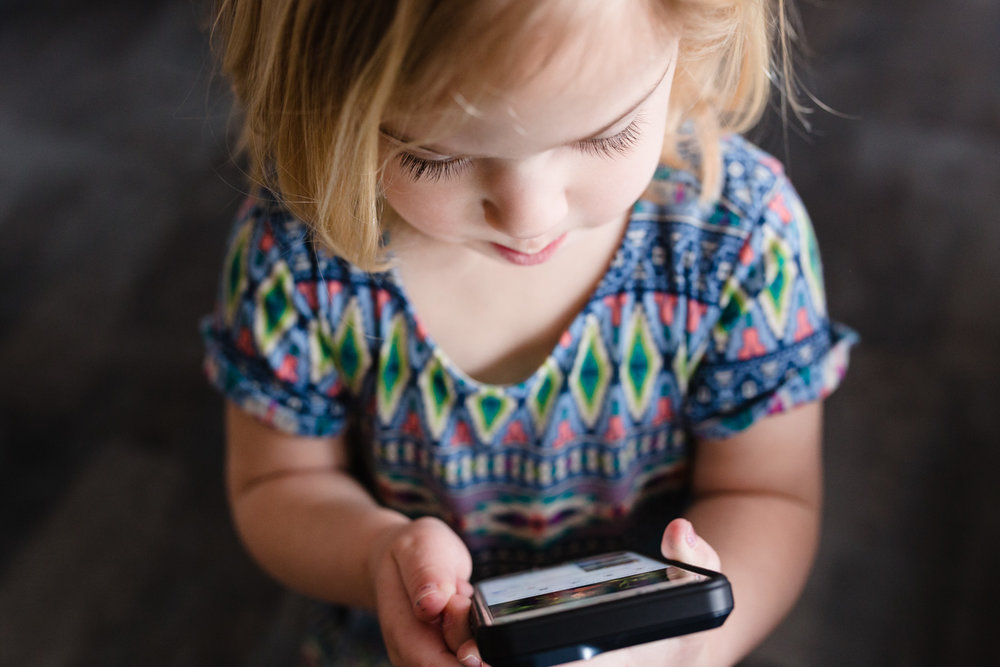 little girl with a cell phone