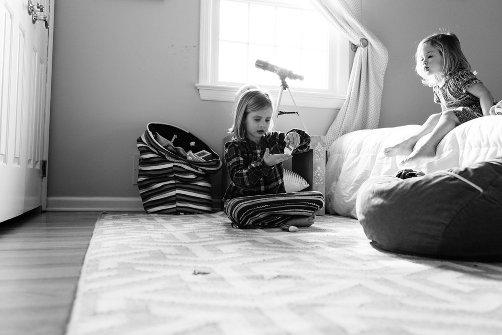 sisters playing in a bedroom