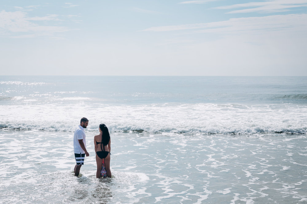 Parents with child in water | NJ Beach Photographer