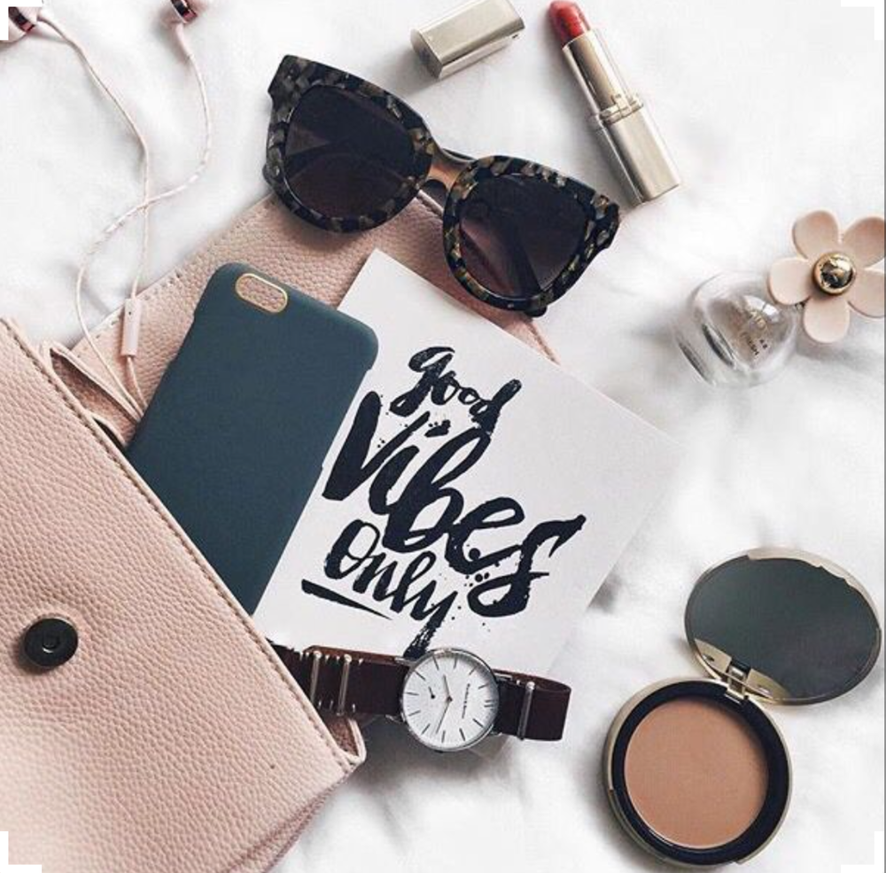Ray-ban showcases their sunglasses in a fun flatlay.