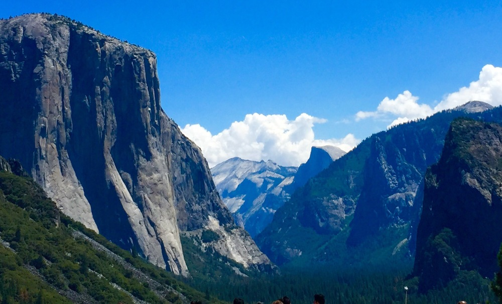 This is one of the most iconic views in Yosemite - Tunnel View. While there's an actual traffic tunnel the tight spacing of the valley's walls produces a tunnel-like visual effect. El Cap on the left, Half Dome on the right.