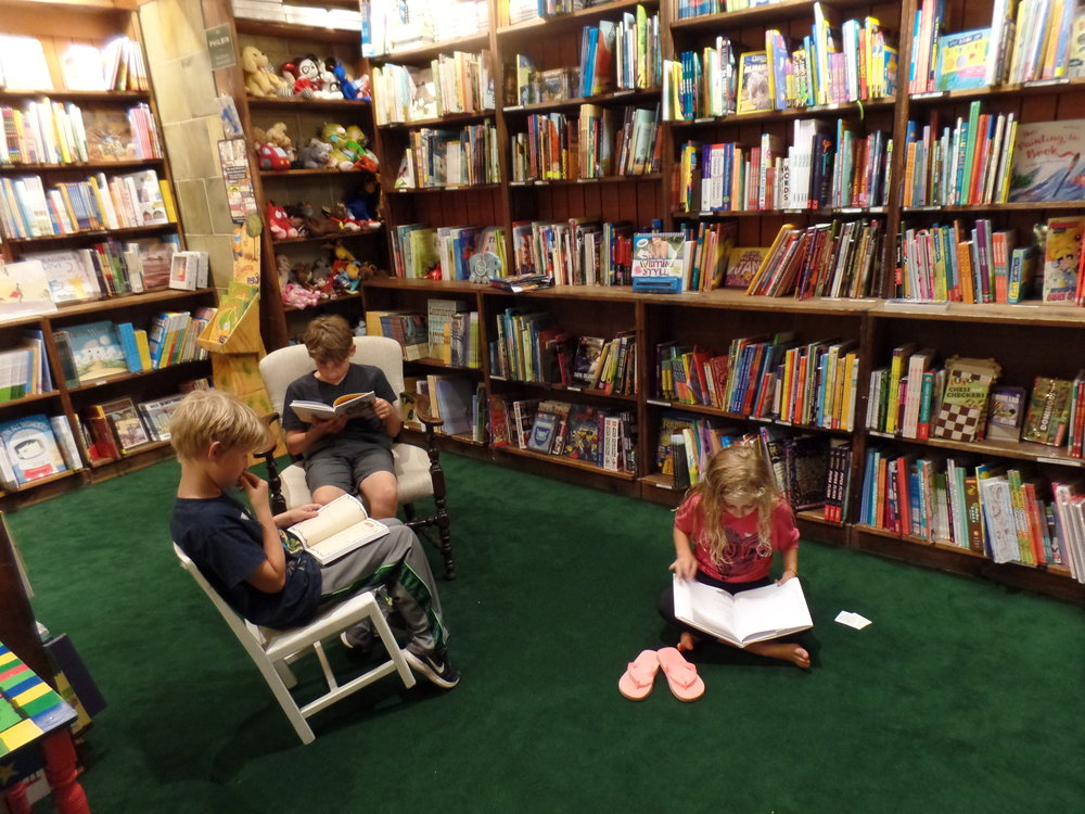 The kids found a book and settle in immediately. Pretty sure this is indicative of an awesome bookstore.