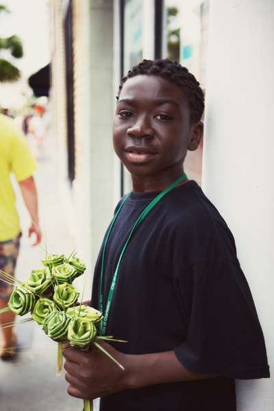Cute little guy selling flowers on King Street.