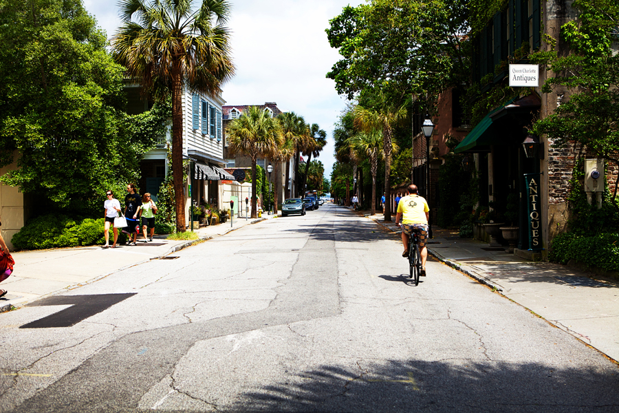 My brother riding his bike down his favorite street in Charleston.