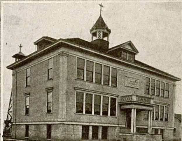 St. Andrew Nativity school in 1908 when it was an elementary school. It was run by nuns that lived on the top floor of the school, before that part of the school was destroyed in a fire.