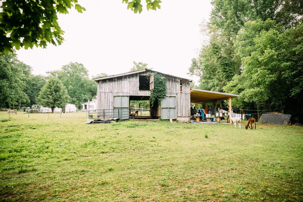 Kacie's barn, with it's new workshop pavillion. Photo by Grace Boto