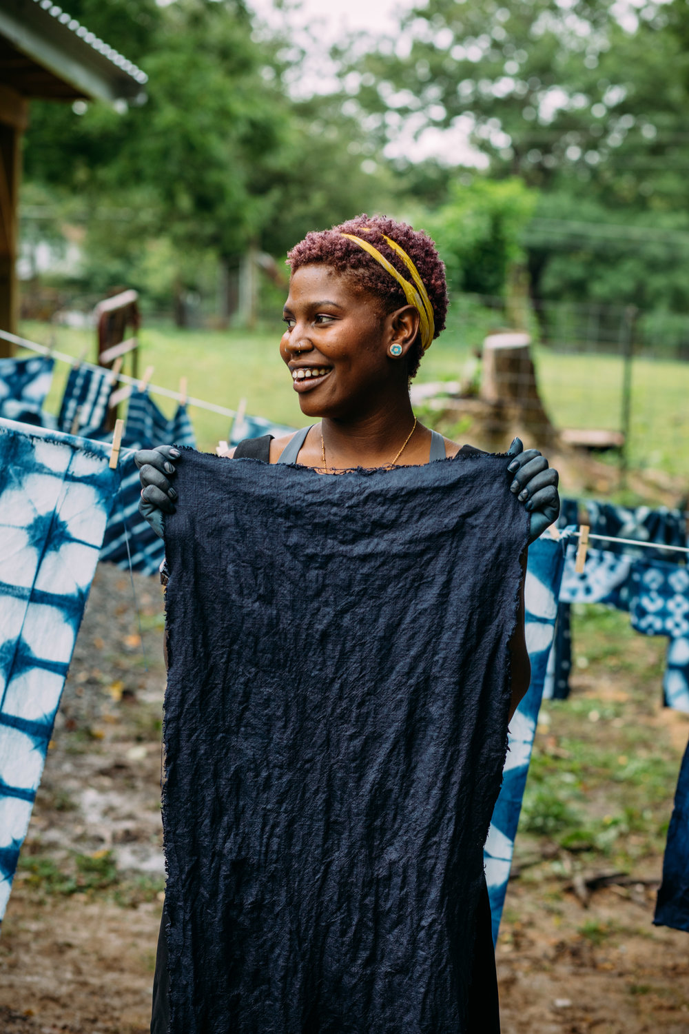 Felistas with her beautifully rich indigo-dyed linen. Photo by Grace Boto