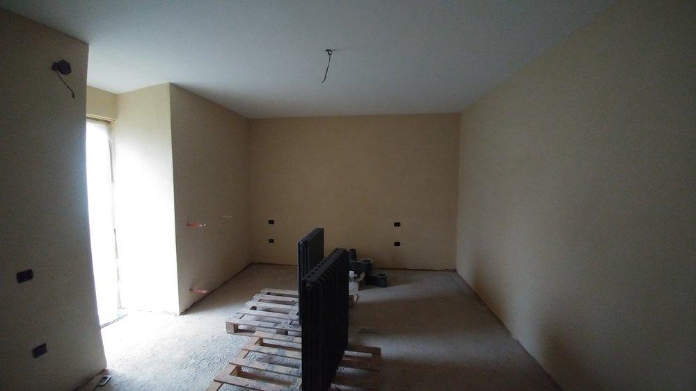 La camera da letto intonacata con argilla