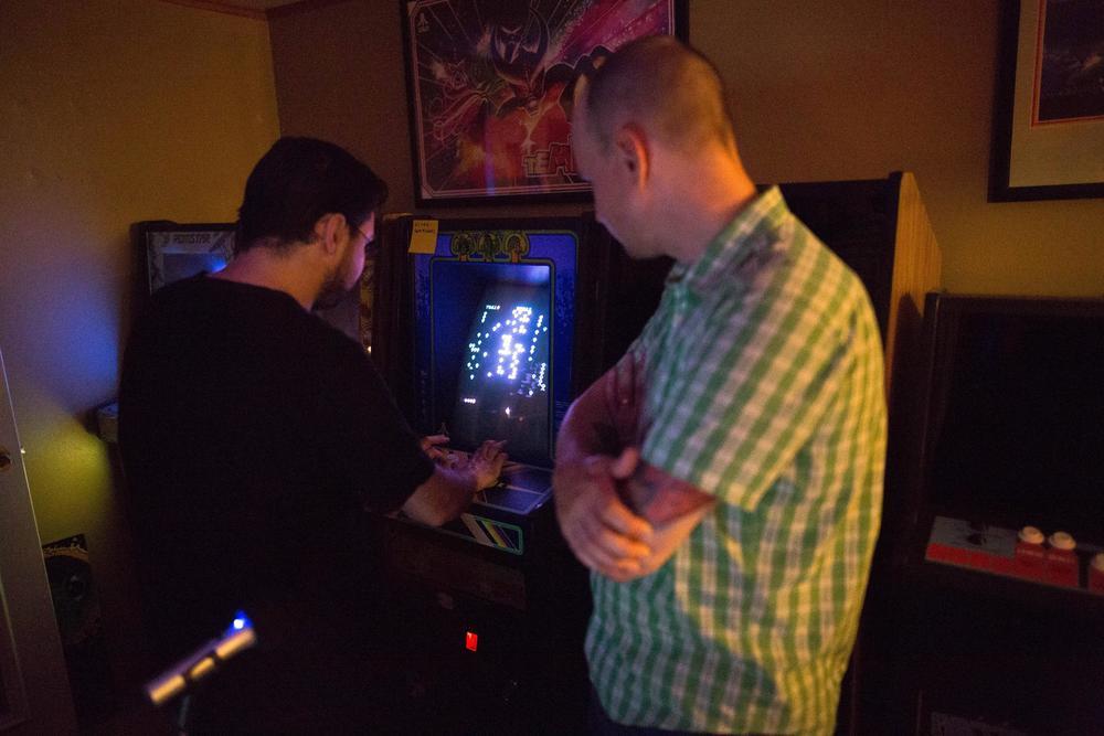 Ian playing CENTIPEDE. BAD Brian admires, skill.