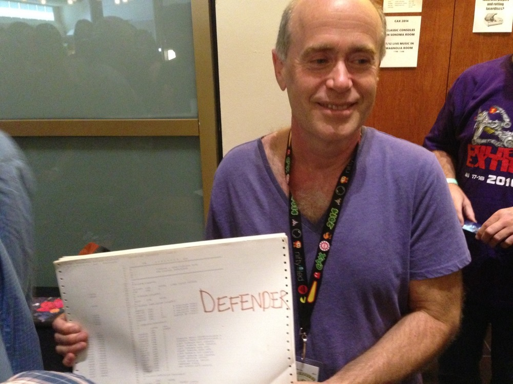 Sam Dicker with a printout of the Defender source code from CAX 2014