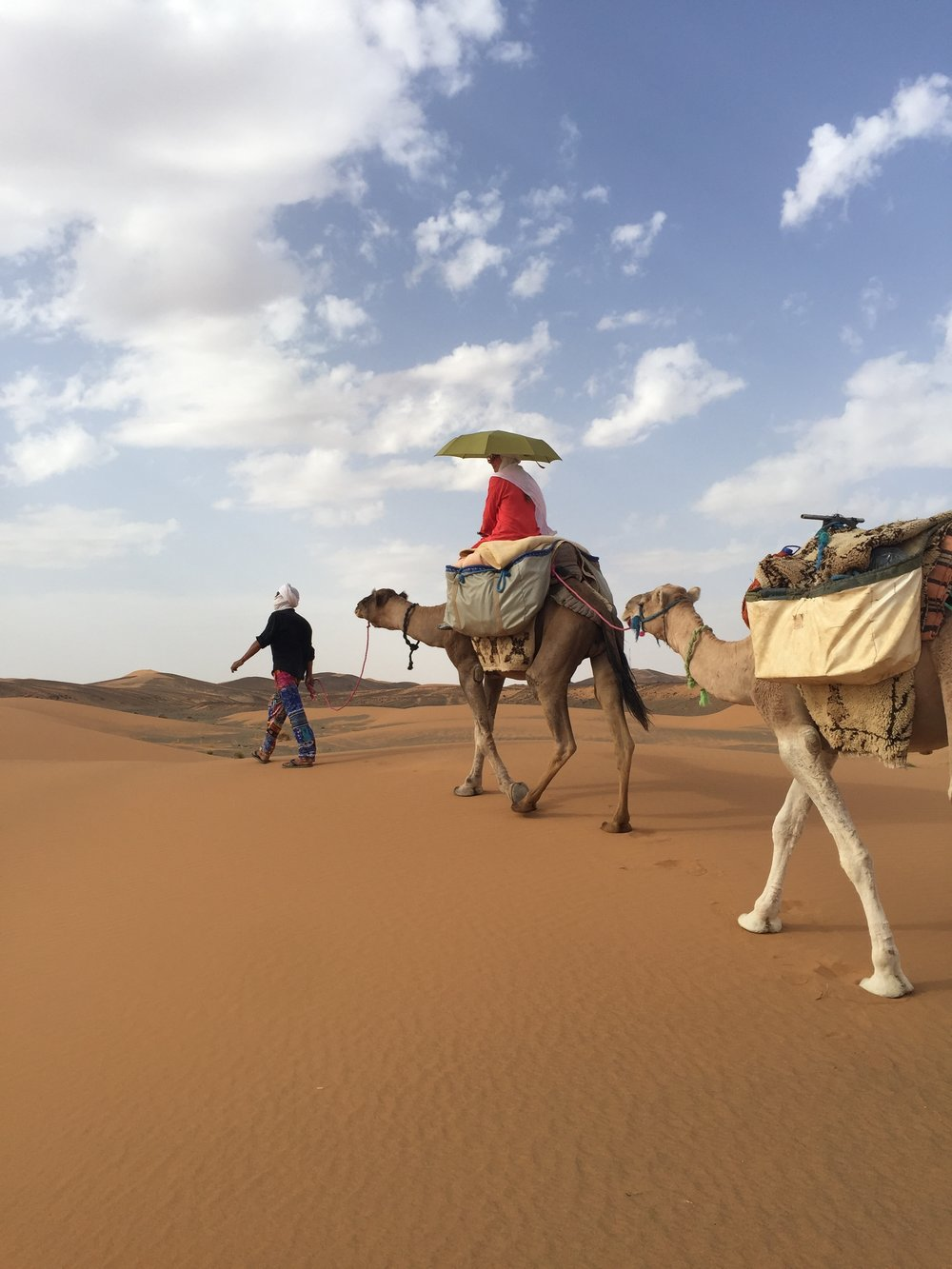 Making my own shade in the Sahara. I didn't realize this is done via turban not umbrella.