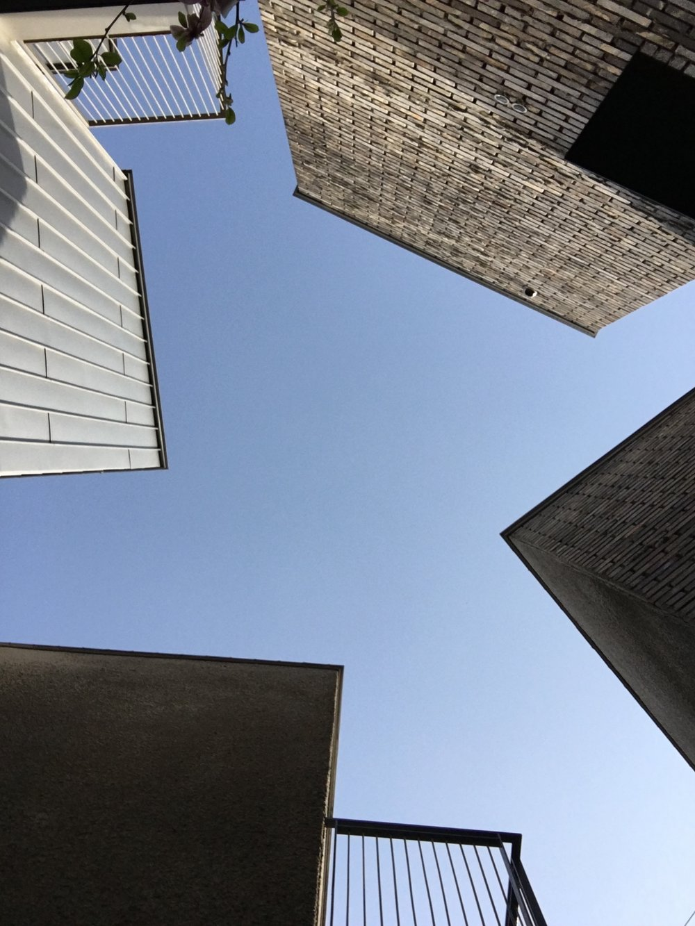 Looking up to the amazing negative space made by the buildings of Inside Busan Hostel.