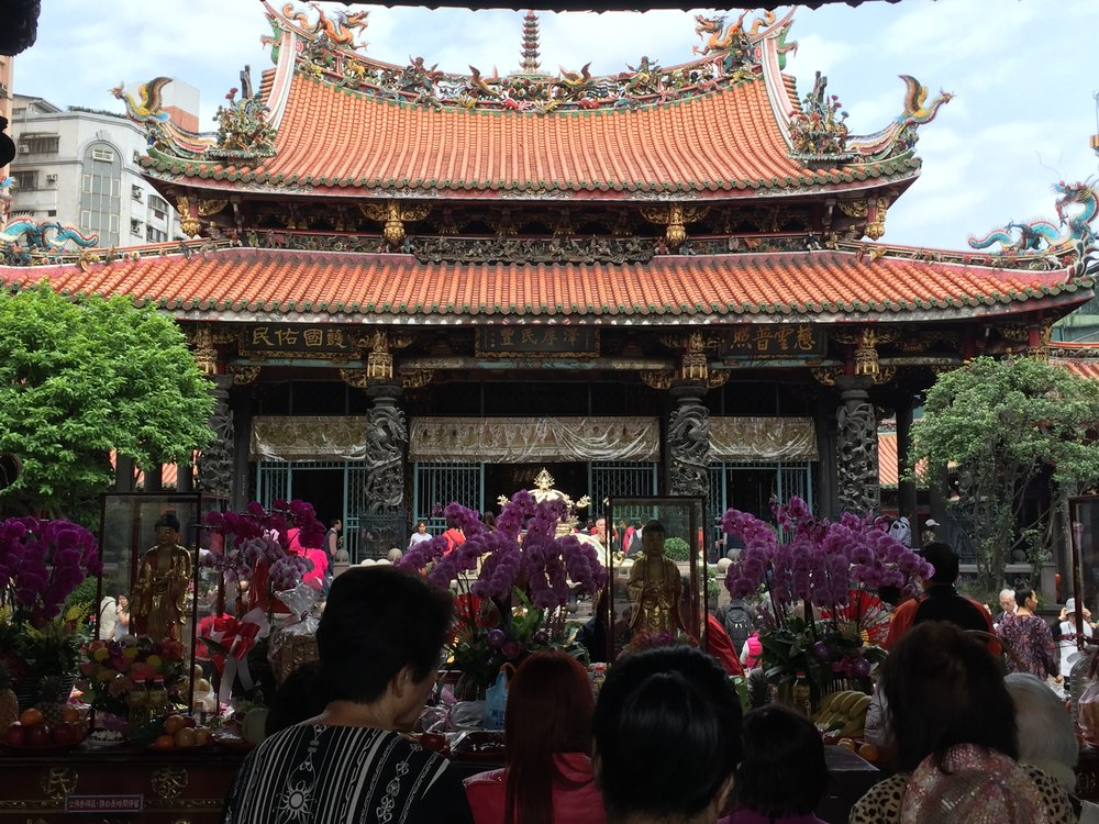 Devotees at the Lungshan Temple in Taipei, Taiwan