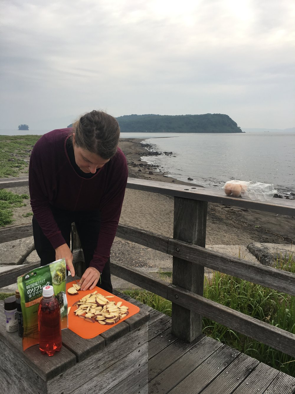 Making breakfast on the shores of the water