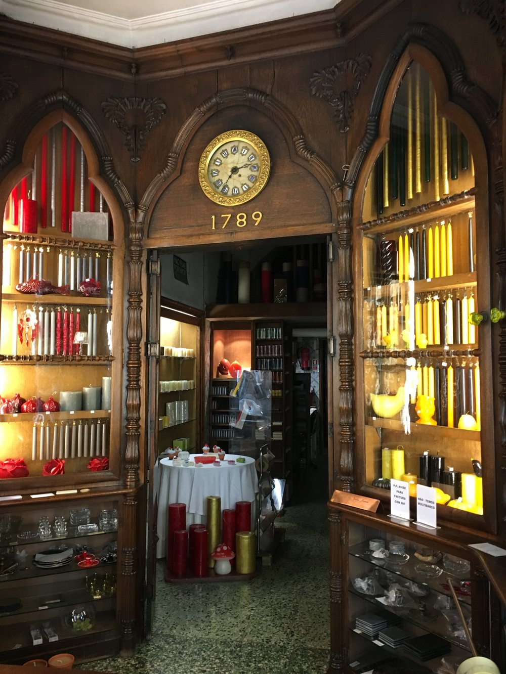 Behind the counter at Vellas Loreto Candle Shop: Notice the mushroom candle?
