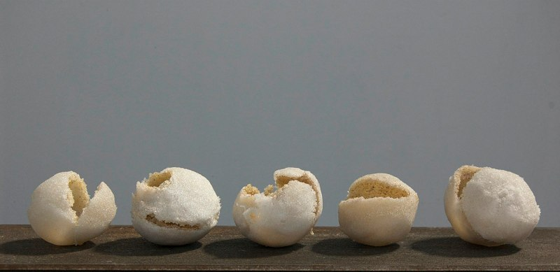 Maquettes (Empty Series), 2013 kiln fired sintered glass approximately 3.5 x 3.5 x 3.5 inches each; 4 x 20 x 3 overall