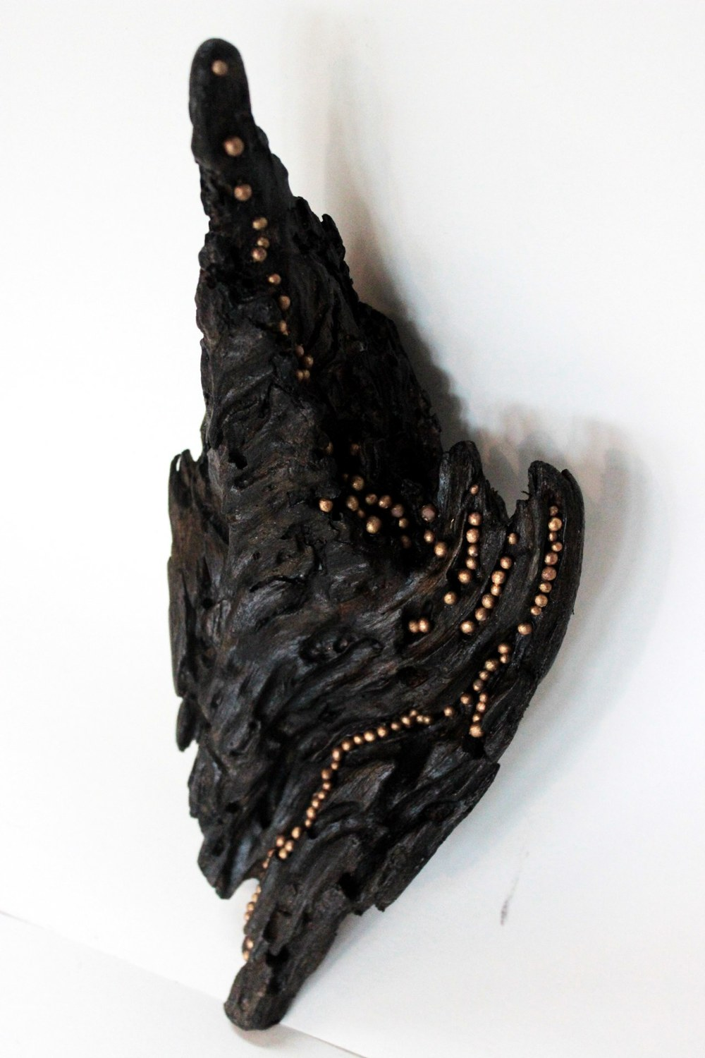 A Luminous Stream of Thought, 2014 gold leaf, polymer clay, acrylic on driftwood 11 x 5 x 3 inches