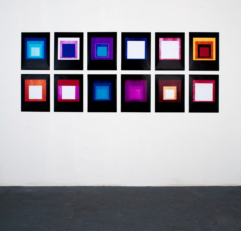 Jason Kalogiros Hommage au Carre, Cool White 40 watt Albers 2, 2010 12 unique photograms each 17 x 14 inches,  36 x 96 inches overall