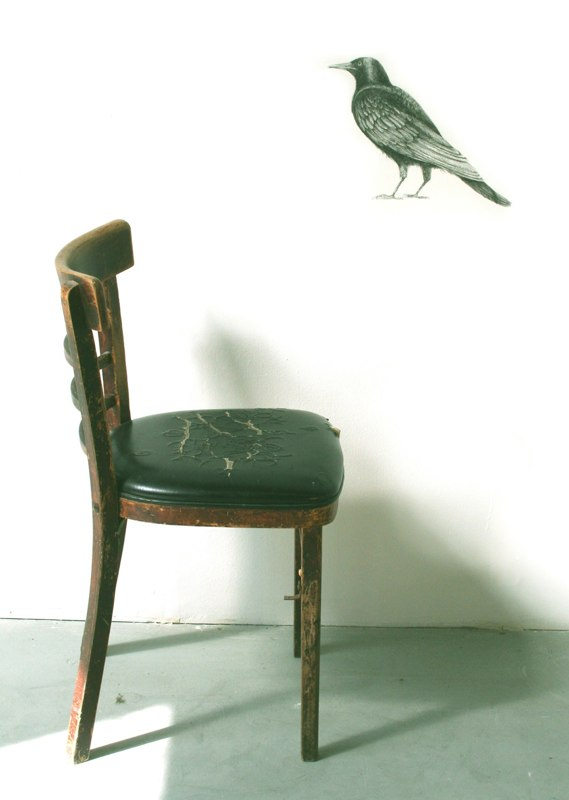 Conversation with a Crow, 2010, graphite drawing on wall with found object / chair, 46 x 32 x 22 inches