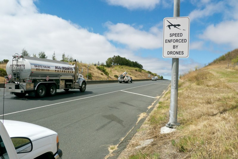 Speed Enforced by Drones, site installation view, Highway 37, Northern California, 2013, vinyl and aluminum, 48 x 32inches