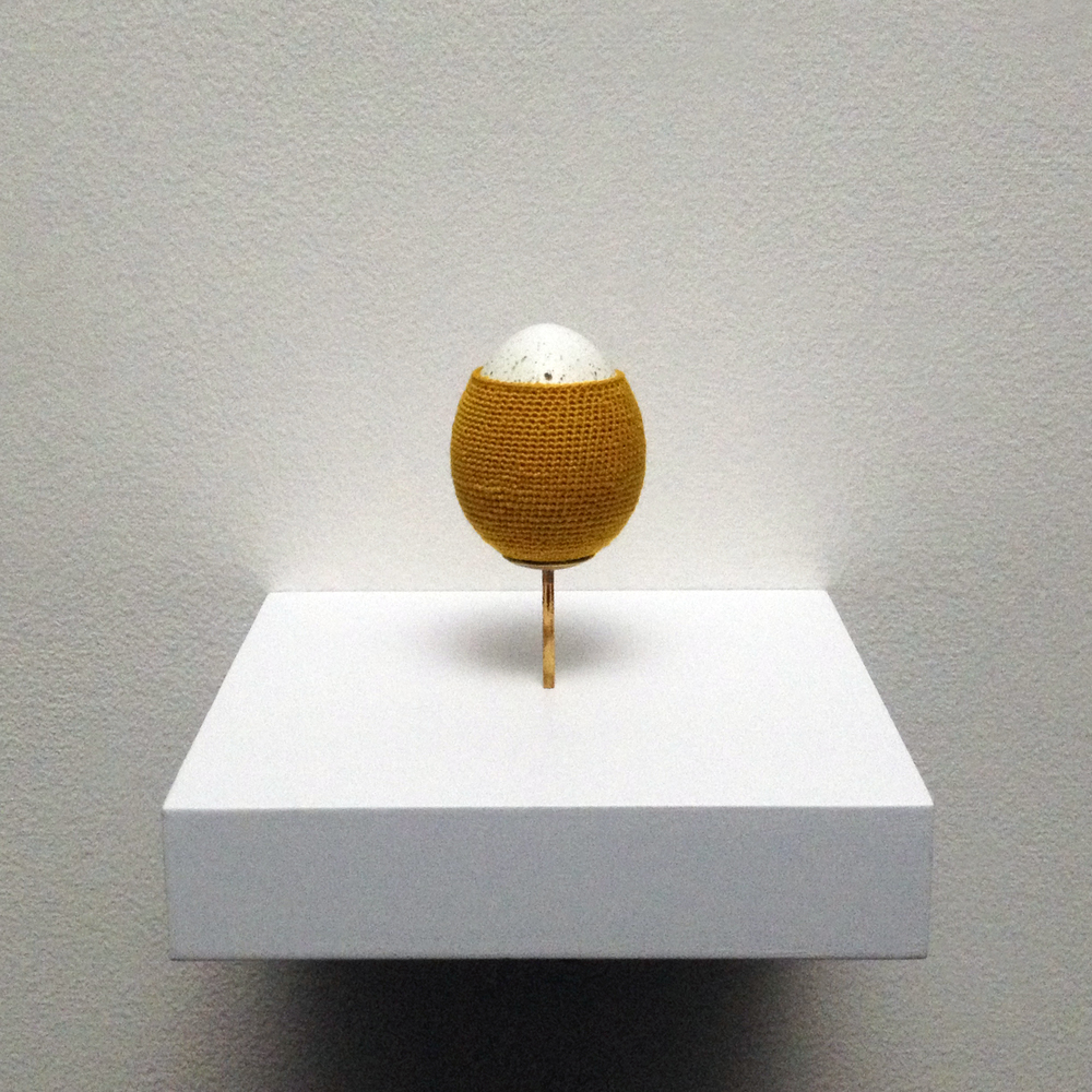 Esther Traugot, Quail Egg 5 (Series 3), 2015, Coturnix eggshells, hand-dyed cotton thread, brass mount, wood shelf, 3 1/2 x 3 x 3 inches