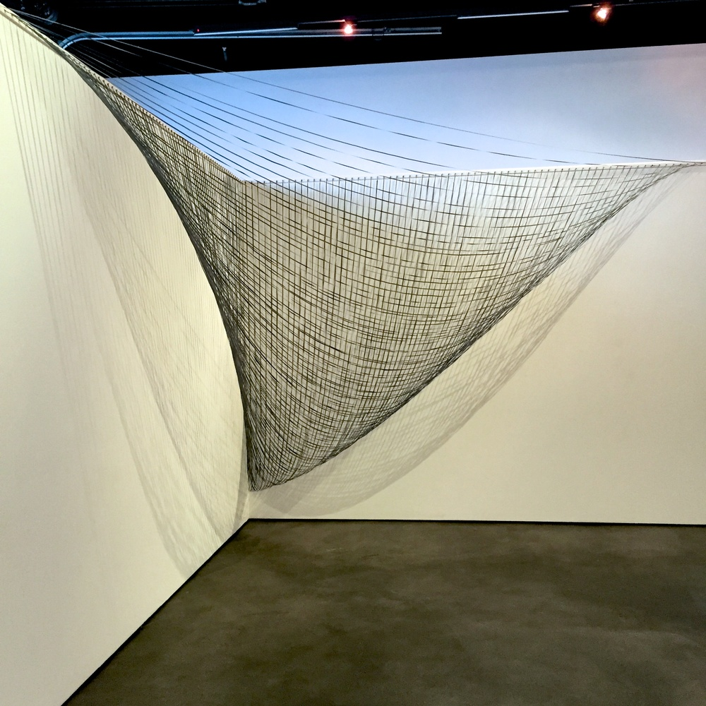 Grey Funnel, 2015, grey ribbon, wood strips, 9 x 12 x 12 feet, installation at the Art Museum of Sonoma County, 2015