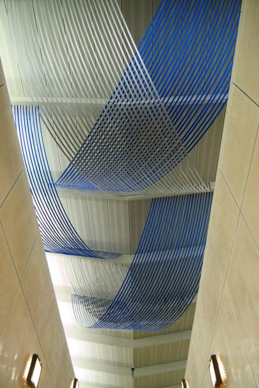 Factor of Five, 2014, 1 inch nylon webbing, aluminum channel, 17 x 32 x 32 feet
