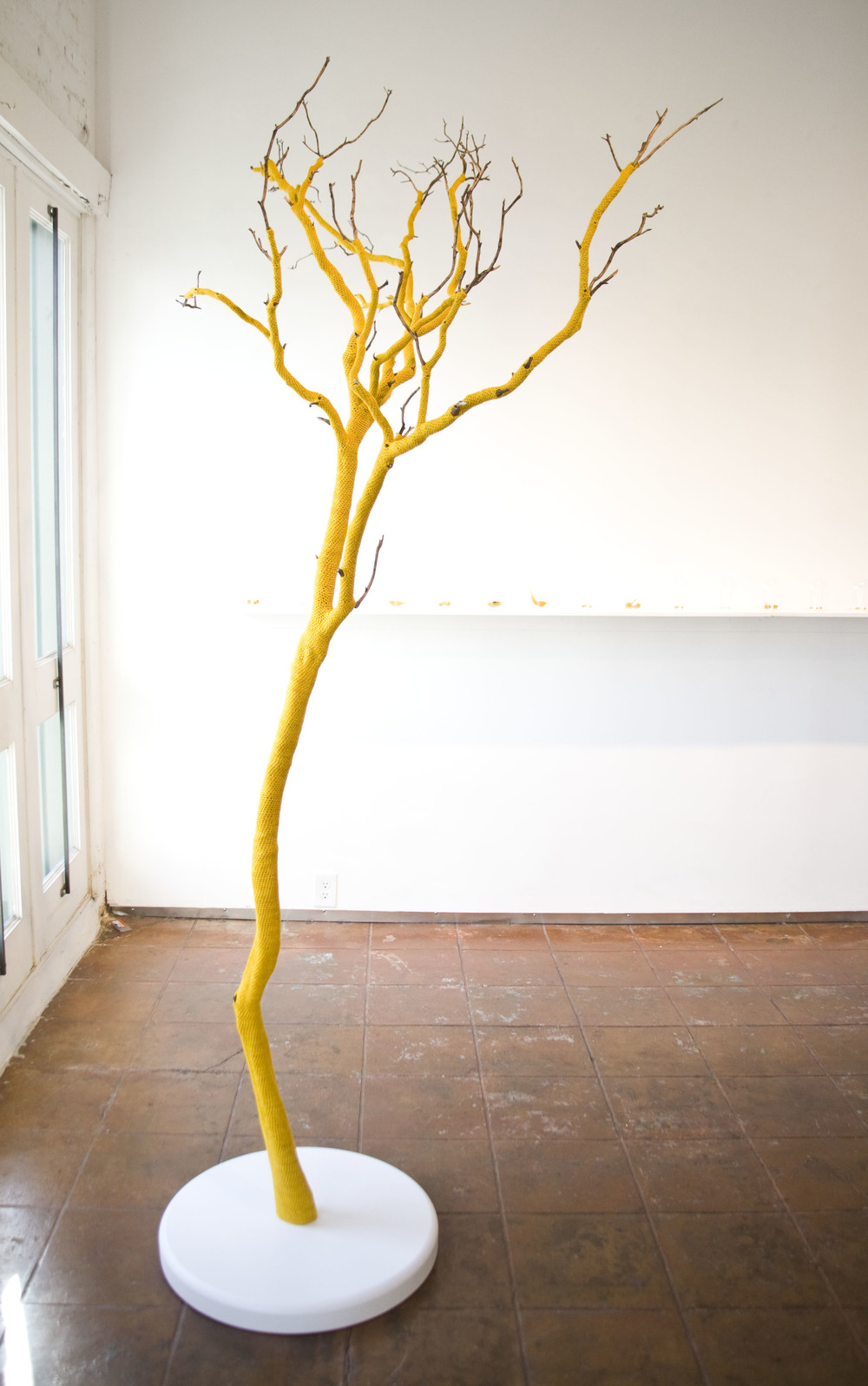 Untitled (standing tree), 2014, tree limb, hand-dyed bamboo yarn and cotton thread, 90 x 54 x 27 inches