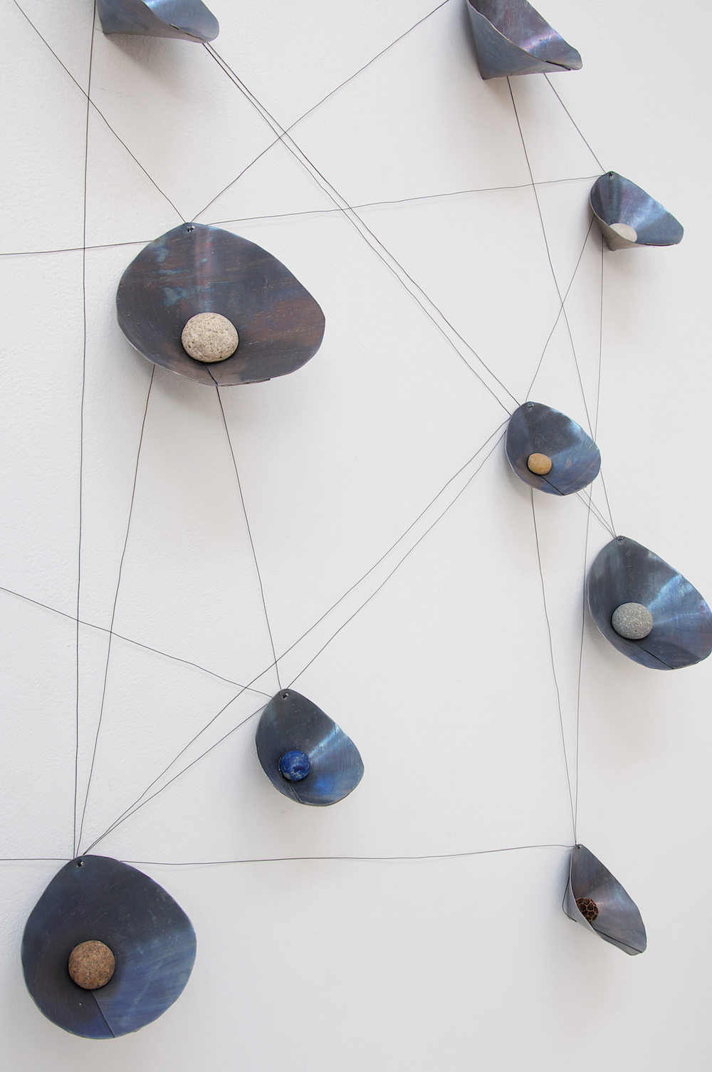 "Mari Andrews, ""The Very Small Array,"" 2016, lead, wire, stone, pods, dimensions variable"