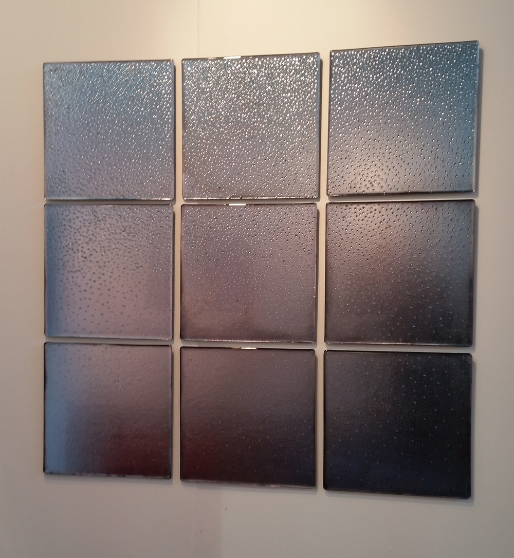 """Jenn Shifflet, """"Star Dust,"""" 2016, hand silvered kiln formed glass; 16 x 16 inches each; 48 x 48 inches"""
